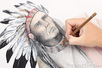 Man hand drawing picture with chieftain