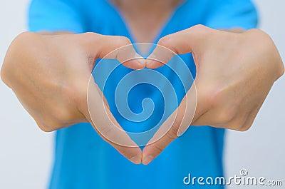 Man hand in heart shape reach out