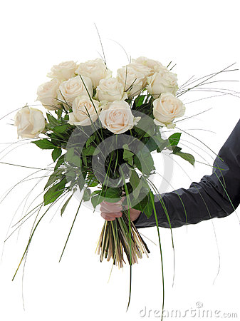 man hand holding bunch of white roses