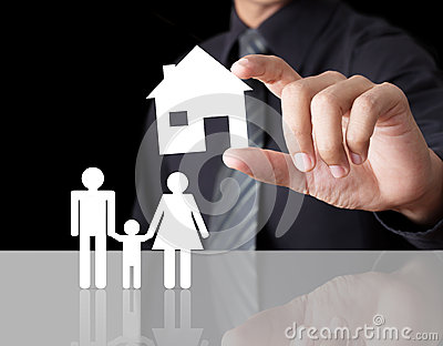 Man hand holding paper house with family
