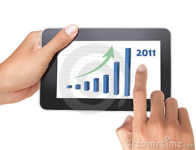 Man hand holding a touch tablet of growing chart
