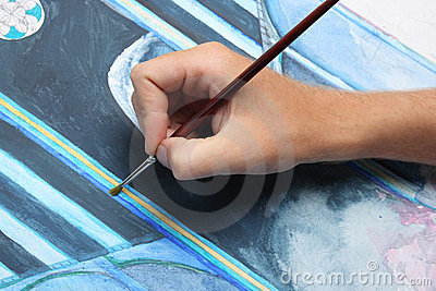 Man hand painting blue picture