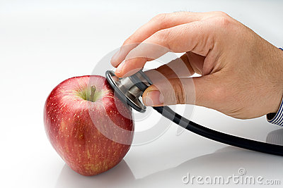 Doctor Examining Red Apple