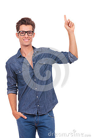 Man with hand in pocket points up