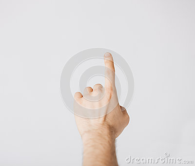 Man hand pointing at something