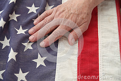Man with hand on USA flag