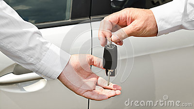 Man handing another person automobile keys new