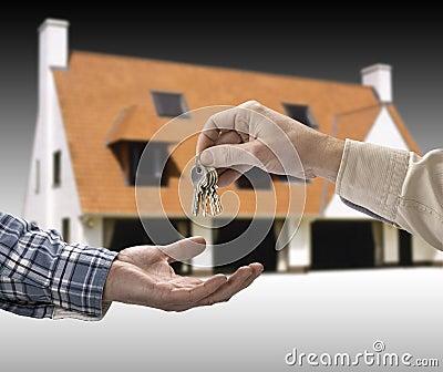 Man is handing a house key