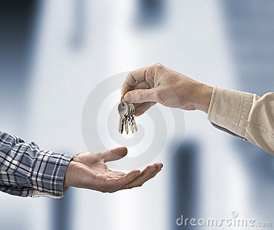 Man is handing a house key
