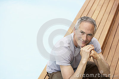 Man With Hands On Chin Relaxing By Pool