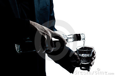 Man hands close up pouring white alcohol
