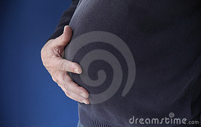 Man with hands on his belly
