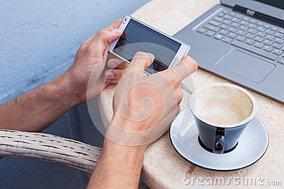 Man hands holding mobile phone,smartphone.