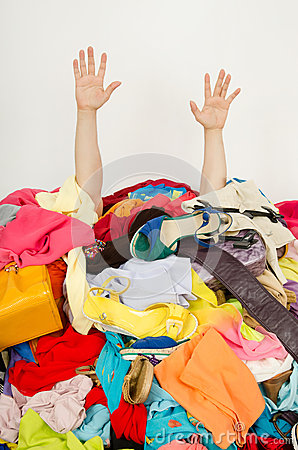 Free Man Hands Reaching Out From A Big Pile Of Clothes And Accessories. Stock Photography - 41185362