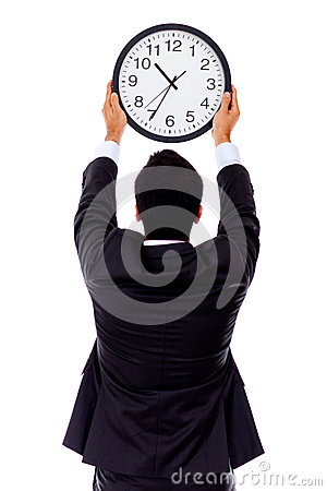 Man hanging a clock