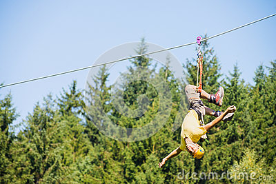 Man Hanging Upside Down On Zip Line
