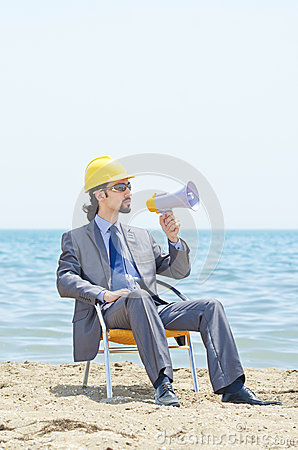 Man with hard hat and loudspeaker