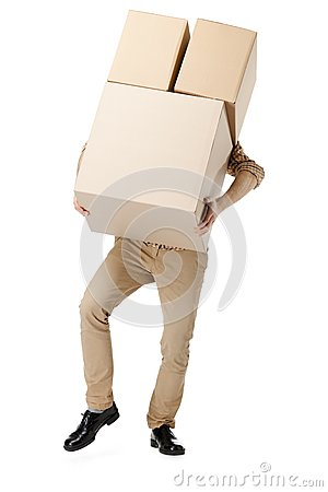 Free Man Hardly Carries The Box Royalty Free Stock Photography - 26417247