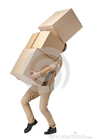 Free Man Hardly Carries The Cardboard Boxes Royalty Free Stock Image - 25973846