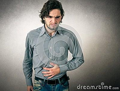 Man has stomach pain Stock Photo