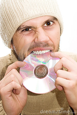 Man with hat breaking CD