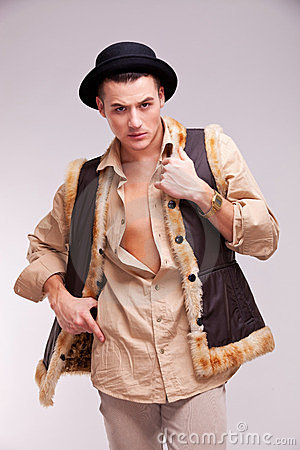 Man with hat and funny fur coat posing