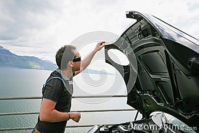 Man having a bad day checks his car