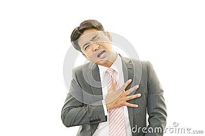 Man having chest pain Stock Photo