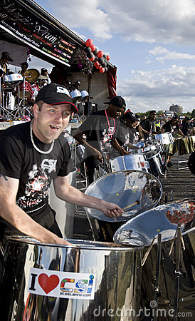 A man having fun and playing steel drums Editorial Stock Photo