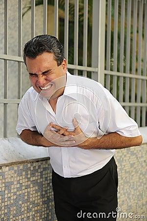 Man having a heart attack bending