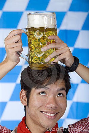 Man having Oktoberfest beer stein on head