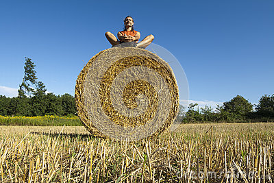 Man on Hay bale