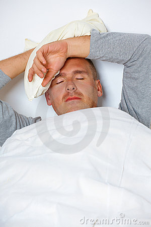 Man with headache in his bed