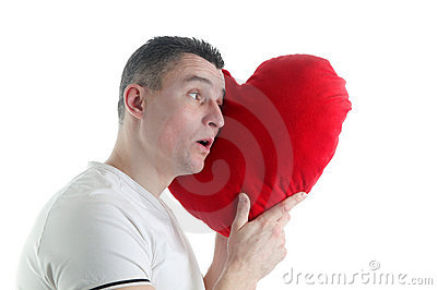 Man with a heart shaped pillow