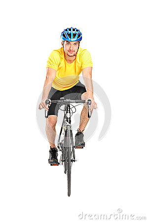 Man with helmet riding a bycicle