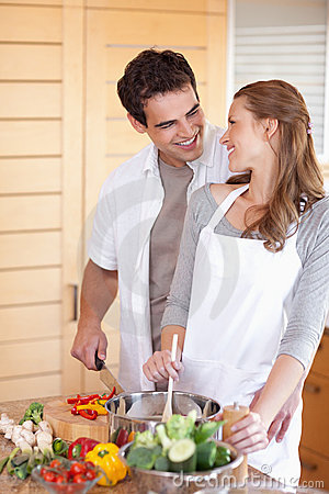 Man helping his girlfriend cooking
