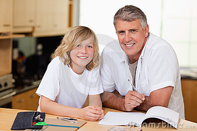 Man helping his son with homework