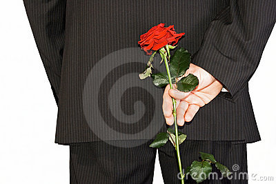 Man hiding back red rose