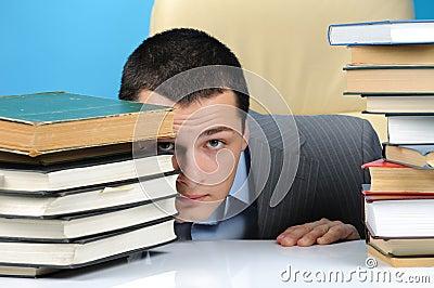 Man hiding in the books