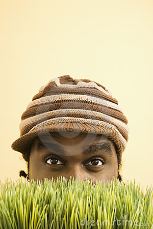 Man hiding in grass.