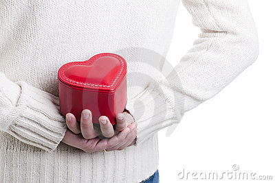 Man hiding a heart shaped box