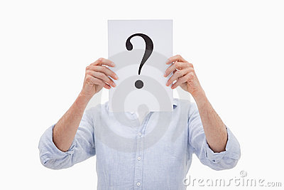 A man hiding his face behind a question mark