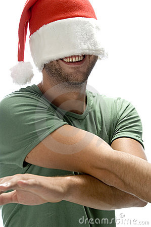 Man hiding his face with santa cap
