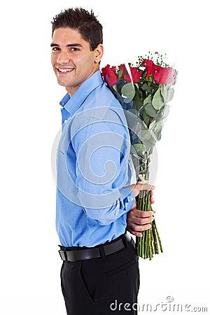 Man hiding roses