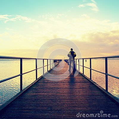 Free Man Hiker On Mole At Sea. Tourist On Wharf Looking Ower Sea To Horizon Stock Image - 84719261