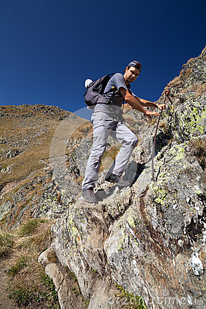 Man hiking on difficult mountain trail