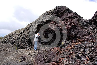 Man hiking in lava splatter zone