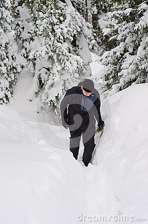 Man hiking in snowy mountains