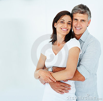 Man with his arms around his beautiful wife