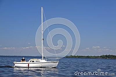 A Man and His Boat - Sailing Lake Champlain Editorial Stock Image